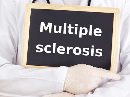 sclerosis: Doctor shows information: multiple sclerosis Stock Photo