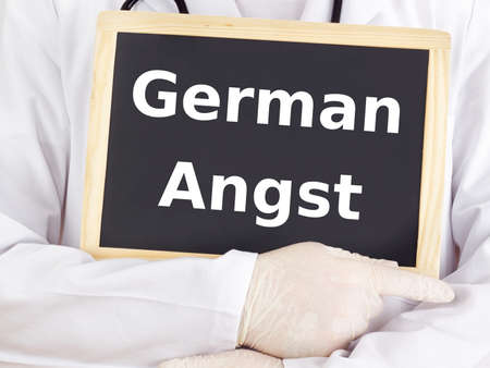 angst: Doctor shows information on blackboard: german angst