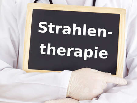 radiation therapy: Doctor shows information: radiation oncology Stock Photo
