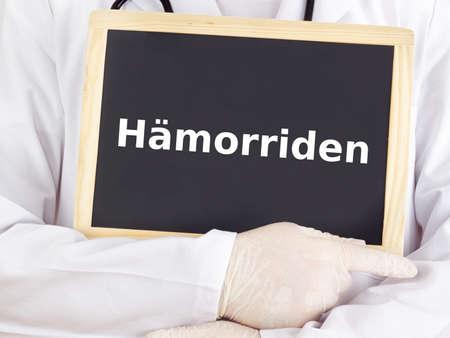 Doctor shows information on blackboard: hemorrhoids Stock Photo - 16160729