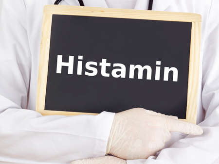 Doctor shows information on blackboard: histamine photo