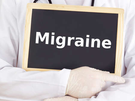 Doctor shows information on blackboard: migraine Stock Photo - 16160720