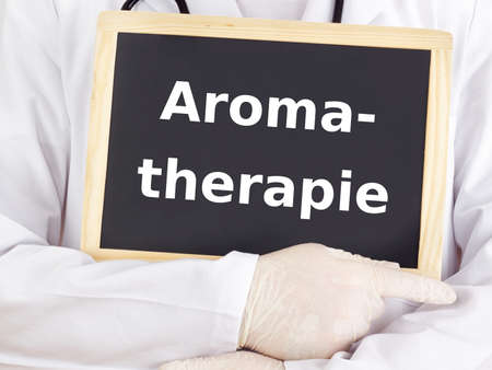 alternative practitioner: Doctor shows information on blackboard: aromatherapy