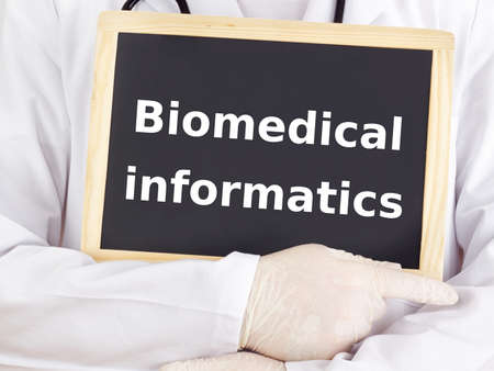 Doctor shows information: biomedical informatics photo