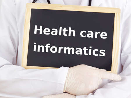 Doctor shows information: health care informatics photo