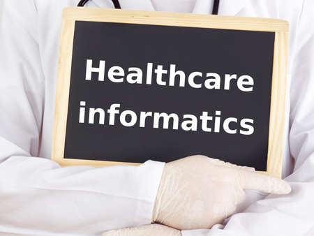 Doctor shows information: healthcare informatics photo