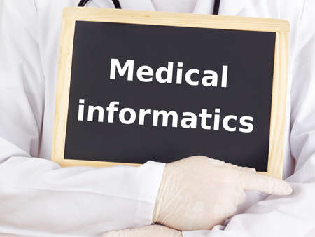 Doctor shows information: medical informatics photo