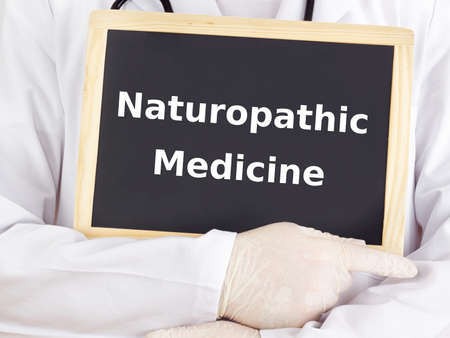 Doctor shows information: naturopathic medicine photo