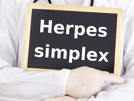 Doctor shows information: herpes simplex Standard-Bild