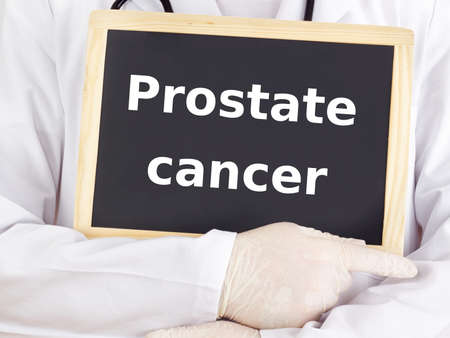 Doctor shows information: prostate cancer Stock Photo