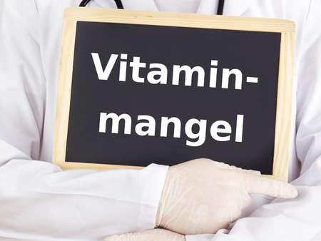 deficiency: Doctor shows information: vitamin deficiency
