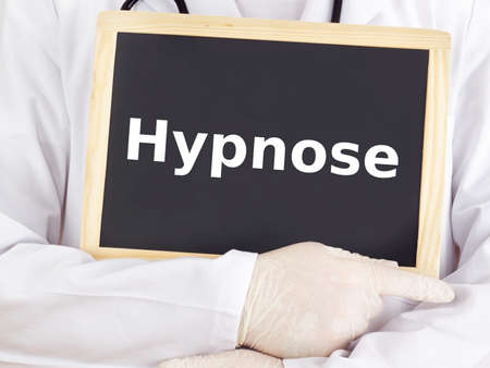 Doctor shows information on blackboard: hypnosis Stock Photo