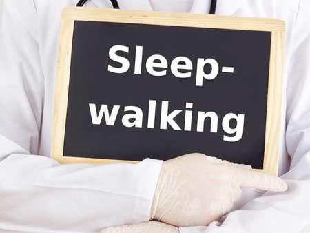 somnambulism: Doctor shows information on blackboard: sleepwalking Stock Photo