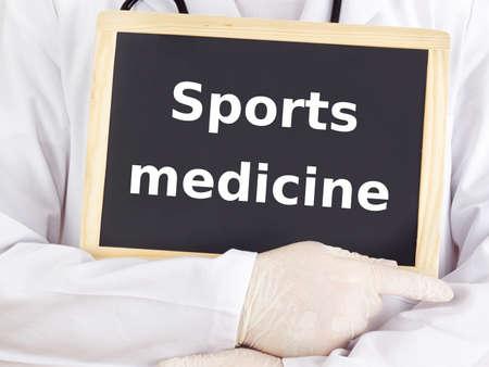 Doctor shows information on blackboard: sports medicine