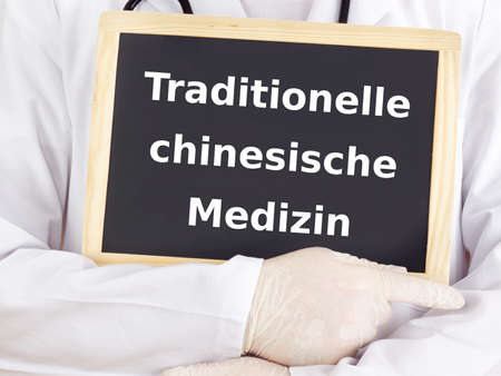 and traditional chinese medicine: Doctor shows information: traditional chinese medicine Stock Photo