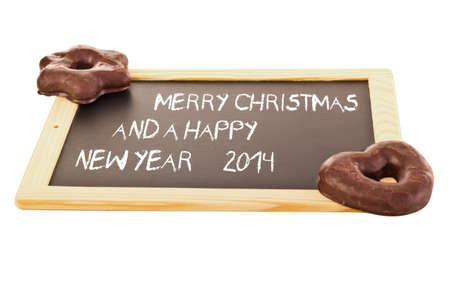 titbits: Gingerbreads on blackboard Stock Photo
