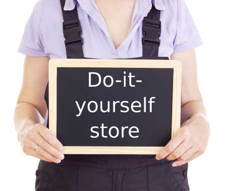 doityourself: Craftsperson with blackboard: do-it-yourself store Stock Photo