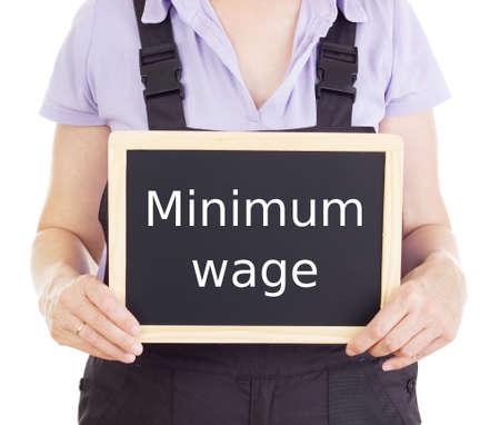 minimum wage: Artesano con la pizarra: salario m�nimo