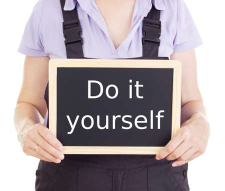 do it yourself: Craftsperson with blackboard: do it yourself Stock Photo