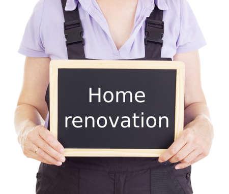 bib overall: Craftsperson with blackboard: home renovation Stock Photo