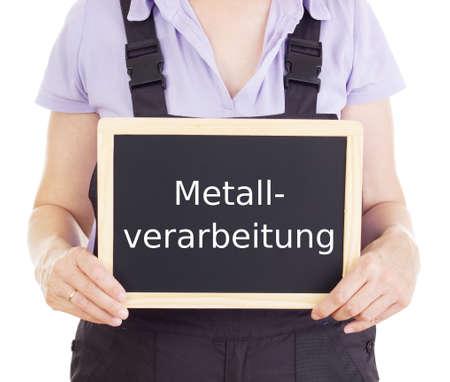 bib overall: Craftsperson with blackboard: metalworking Stock Photo