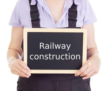 bib overall: Craftsperson with blackboard: railway construction