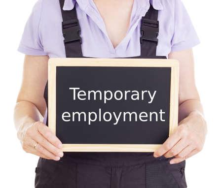 Craftsperson with blackboard: temporary employment Standard-Bild
