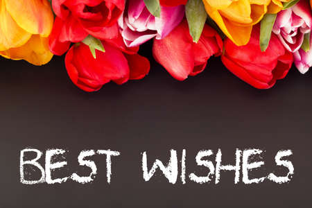 best wishes: Bunch of tulips with blackboard: best wishes Stock Photo