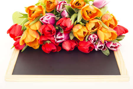 Bunch of tulips with blackboard photo