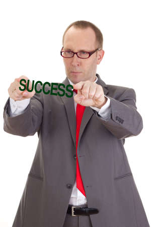 Businessman showing the word success Stock Photo - 18098615