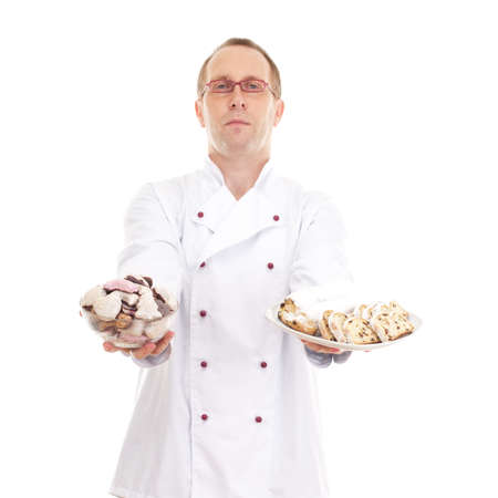 Chef with gingerbread and stollen Stock Photo - 18574289