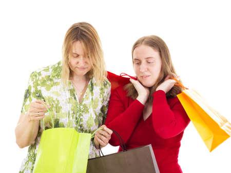 shopaholism: Two women on shopping tour Stock Photo