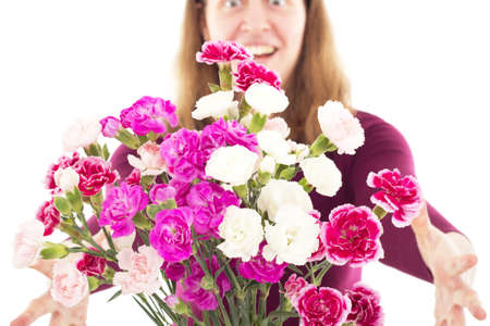 heralds: Woman getting beautiful  bunch of dianthus caryphyllus