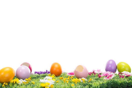 A lot of beautiful Easter eggs on a flowering meadow photo