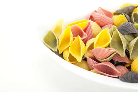 semolina pasta: Uncooked and colorful italian noodles