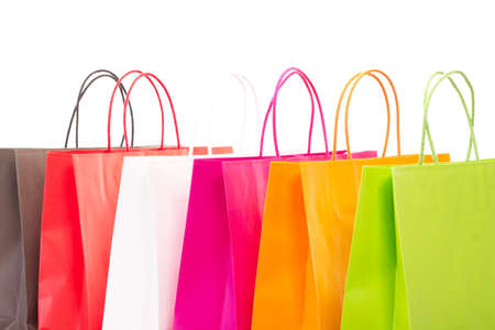 shopaholism: Cut-out of six colorful shopping bags Stock Photo