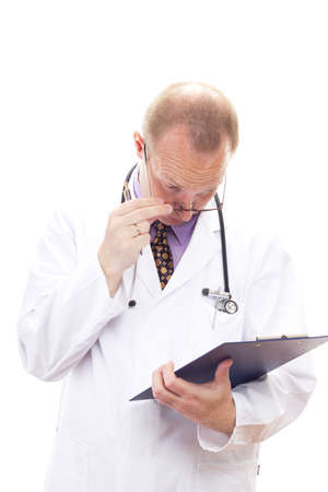 Stunned medical doctor reading patients file