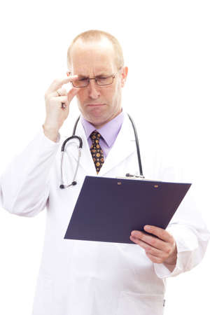unreadable: Male medical physician looking worried on patients record Stock Photo