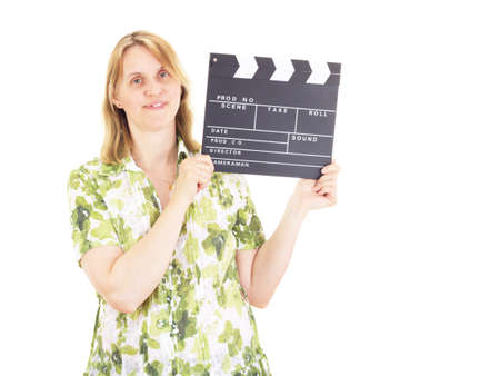 Beautiful woman with clapperboard having fun on location photo