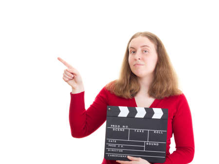 Woman with clapperboard pointing at something photo
