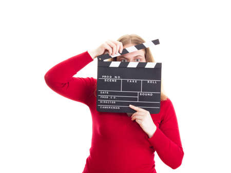 Young woman hiding her face behind clapperboard photo