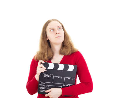 Young woman with clapperboard thinking about something photo
