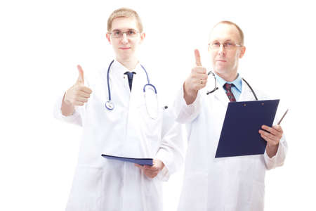 Two male medical doctors showing thumb up Stock Photo