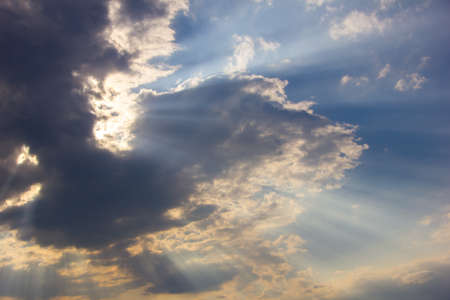 sunup: Sunlight shining through dramatic clouds