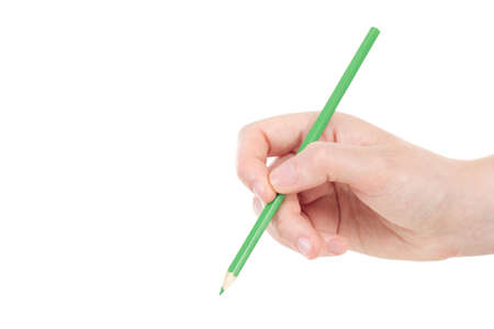 Caucasian hand with green pencil photo