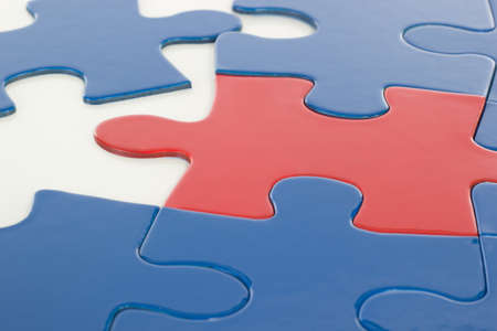 Putting the jigsaw puzzle in teamwork together photo