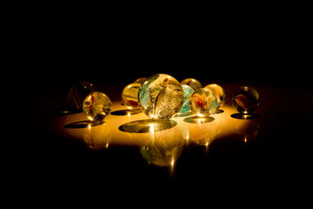 murmur: Group of marbles in the darkness Stock Photo