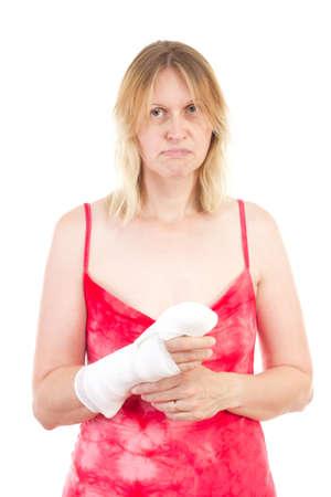 Sad caucasian woman with bandaged hand