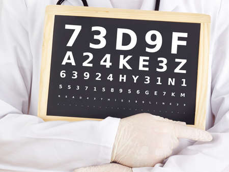 Ophthalmologist holding blackboard with eyesight test photo