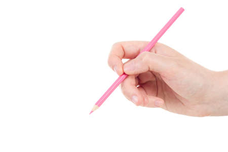 Caucasian hand with pink pencil photo
